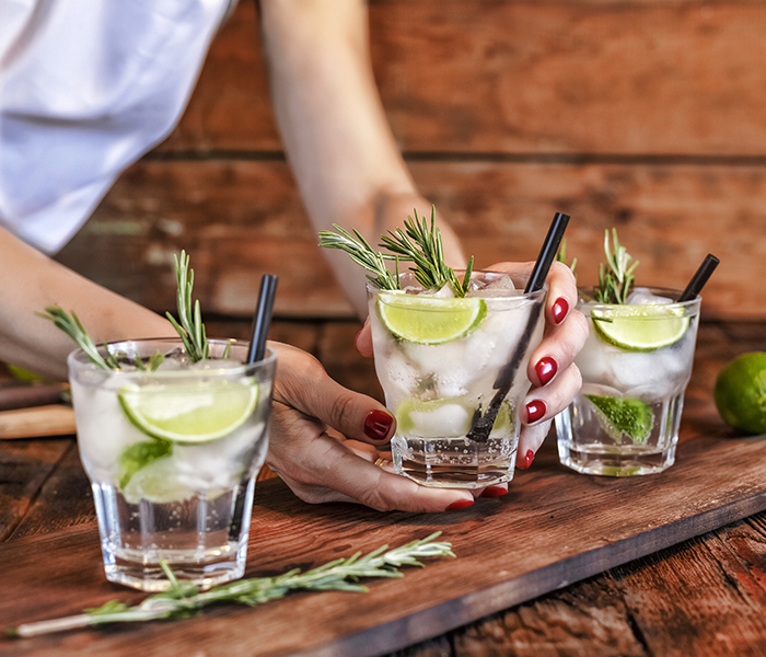 Gin & tonics being served by a bartender