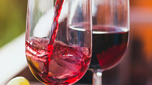 Two glasses of red wines in a vineyard