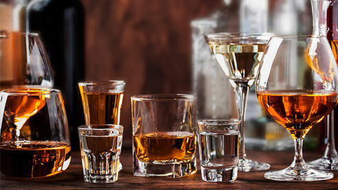 Glasses with different kinds of liqueur on a table