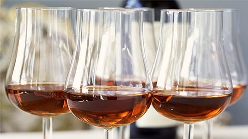 Glasses of tawny port on a wooden table