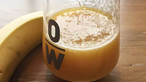 Beer cocktail in a glass with a banana