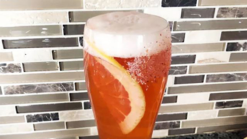 Pomelomosa cocktail with grapefruit wheel