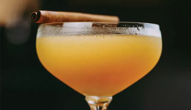 Cocktail with cinnamon stick