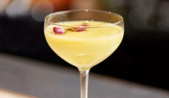 Cocktail with floral garnish