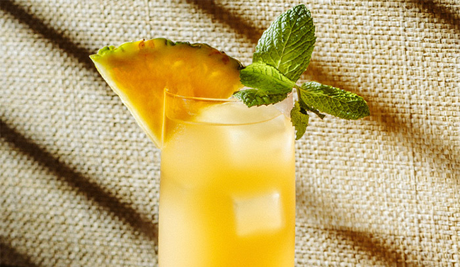 Fruity cocktail with Jamaican rum and a slice of pineapples
