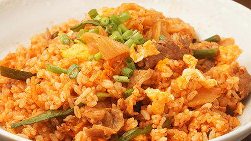 Fried rice with Kimchi in a white bowl