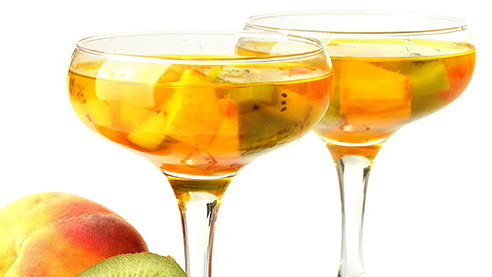 Cava sangrias with fruits against a white background