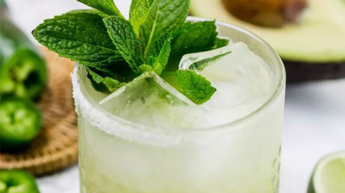 Spicy avocado margarita with mint leaves
