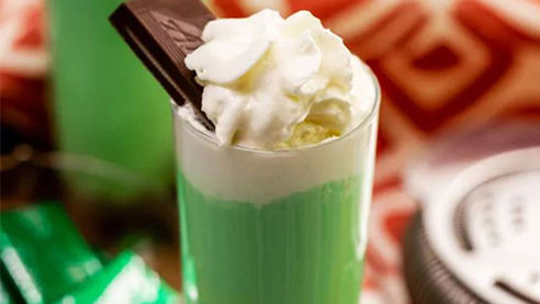 Shamrock shot cocktail with whipped cream and chocolate