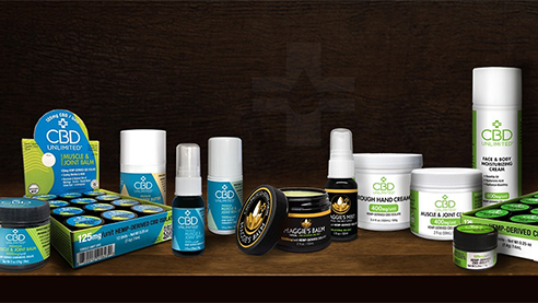 CBD Unlimited products against a dark backdrop