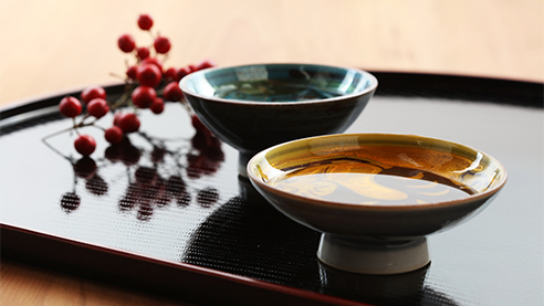Bowls of sake on a table