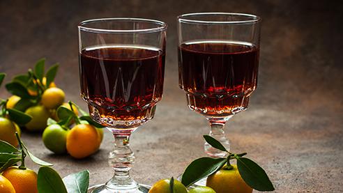 Glasses of fruit liqueurs