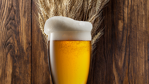 Beer with wheat in the background