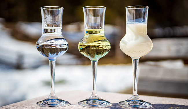 Glasses of grappa brandy on a table