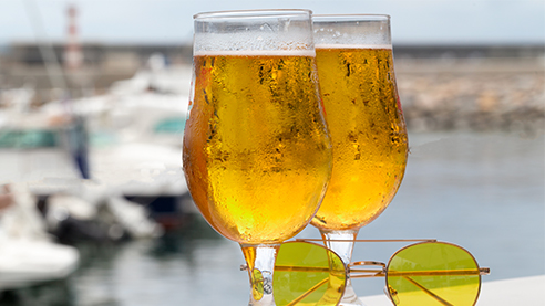 Two glasses of port beer with sunglasses
